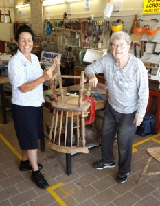 Reg Specker, who is living with dementia, attends the Raymond Terrace Men's Shed once a week as part of the Every Bloke Needs A Shed program. He's pictured here with Karen Adams, one of his carers. Picture: Ben Latimore