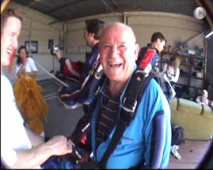 UnitingCare Starrett Lodge resident Allan Rigby before (main photo) and during (inset) his tandem parachute jump in 2006, at the age of 86. Main photo courtesy of UnitingCare Starrett Lodge, video stills courtesy of Just Jump Skydive.