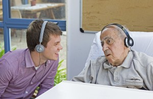 Staff member James Flood with a resident engaging through music