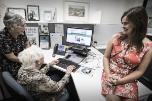 Dr Lyn Phillipson (project leader, right) and Associate Professor Helen Hasan (co-investigator, left) explore the 'Rethink Respite' website with Illawarra carer support group leader Val Fell